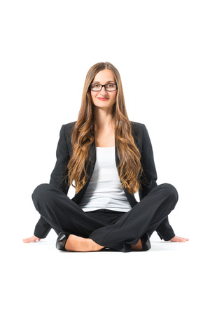 Young business woman with glasses in front of white background, sitting on the floor, maybe she is a businesswoman or laywer Stock Photo - 24283910
