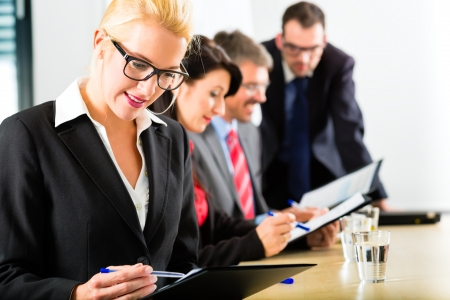 Business - businesspeople have a meeting with presentation in office, they negotiate a contract - Portrait of a businesswoman Stock Photo - 24283914