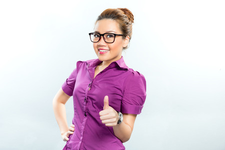 careerist: Asian Business woman having success showing it by giving a thumbs up  Stock Photo