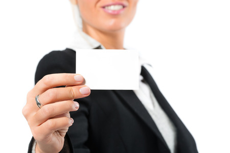 introduces: Young woman on white introduces themselves with a business card