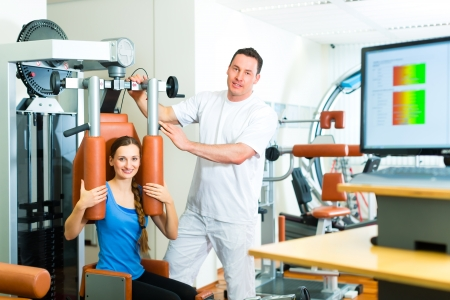 Patient at the physiotherapy making physical exercises with her therapist photo