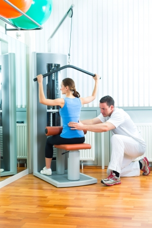 therapy equipment: Patient at the physiotherapy making physical exercises with her therapist Stock Photo