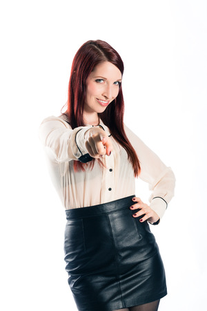 likeable: Young woman pointing with confidence Stock Photo