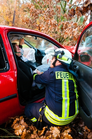 Fire brigade rescues accident Victim of a car Stock Photo - 24353436