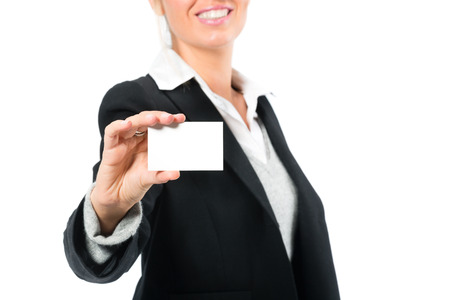 introduces: Young woman in front of white introduces themselves with a business card