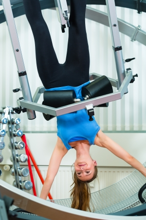 Space Curl - Patient at the physiotherapy making physical exercises with special equipment photo