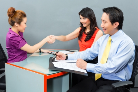 applicant: Job interview with an Asian candidate for an new office employment or negotiation for hiring