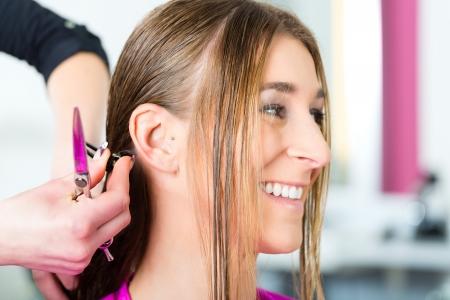 a female customer gets a haircut photo