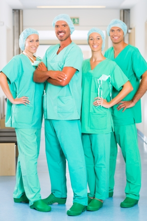 Hospital - medical surgery team is ready for the operation, the women and men wearing scrubs in a clinic photo