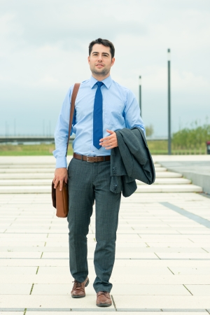 Handsome businessman or manager in leisure time going home photo