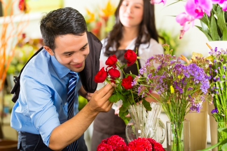 fullness: Young Asian or Indonesian Man is interested for a bouquet Roses