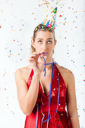 fining: Woman fining birthday party boring with streamer being less than excited Stock Photo