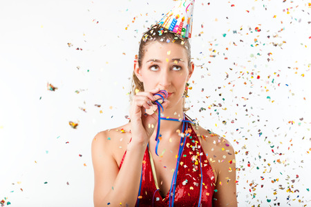Woman fining birthday party boring with streamer being less than excited Stock Photo