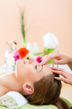 reiki: Wellness - woman receiving head or face massage in spa