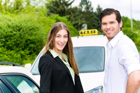 reached: Young woman and driver standing together in front of taxi, she has reached her destination