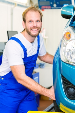 bluey: Mechanic in workshop or MOT with car or auto for service inspection