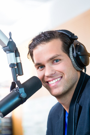 Presenter or host in radio station hosting show for radio live in Studio Stok Fotoğraf