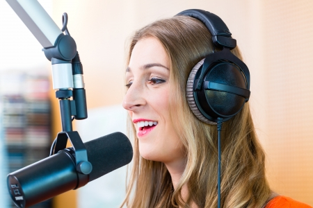 Female presenter or host in radio station hosting show for radio live in Studio photo