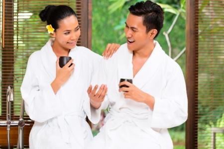 Indonesian Asian couple drinking tea in wellness spa photo