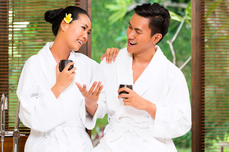 Indonesian Asian couple drinking tea in wellness spa Stock Photo - 25303573
