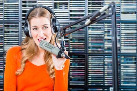 Female Presenter or host in radio station hosting show for radio live in Studio photo
