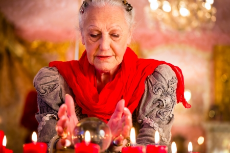 fortuneteller: Female Fortuneteller or esoteric Oracle, sees in the future by looking into their crystal ball during a Seance to interpret them and to answer questions Stock Photo