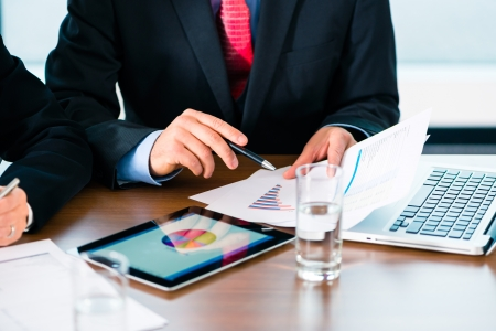 Business - banker, Manager or expert evaluates the figures on tablet computer and compares the development of the business in real time