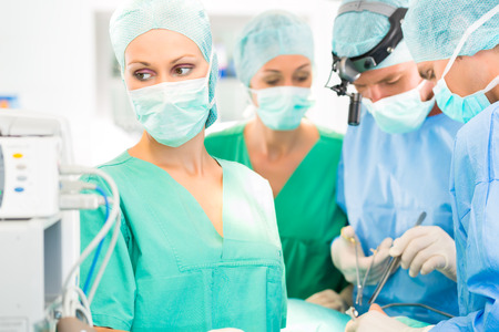operating theater: doctor surgery team in operating room or operation theter of hospital working in emergency situation
