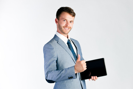 Businessman or manager using pad or tablet computer giving presentation photo