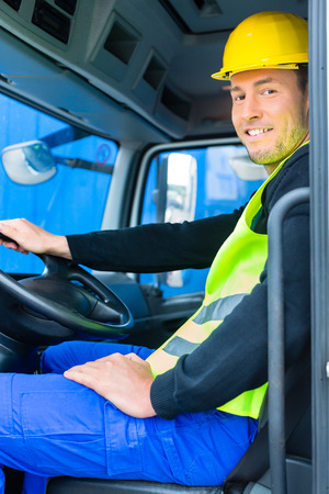 truck driver: driver driving with the truck over building or construction site