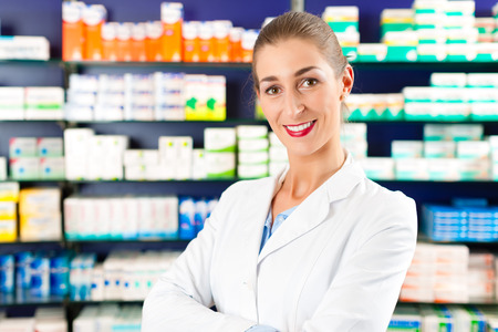 Portrait of female Pharmacist in a pharmacy, she is young, very experienced and trustworthy