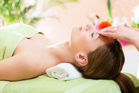 Wellness - woman getting head massage in Spa photo