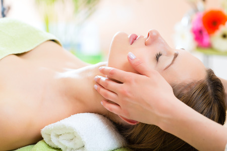 wellness woman: Wellness - woman receiving head or face massage in spa