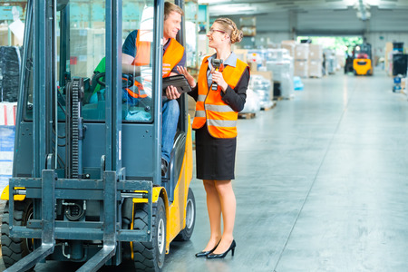 forklift driver: Logistics Teamwork - forklift driver, Worker or warehouseman and his coworker with scanner at warehouse of freight forwarding company