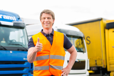 safety vest: Logistics - proud driver or forwarder in front of trucks and trailers, on a transshipment point