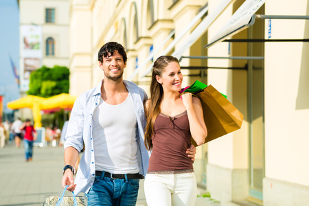 Young couple shopping in inner with shopping bags spending money photo