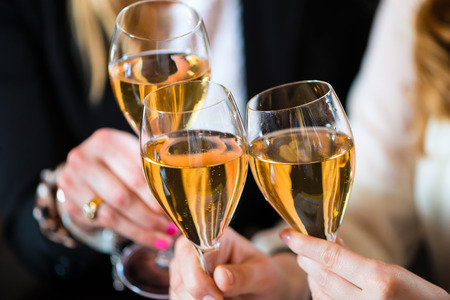 clinking: Young businesswomen clinking with sparkling wine