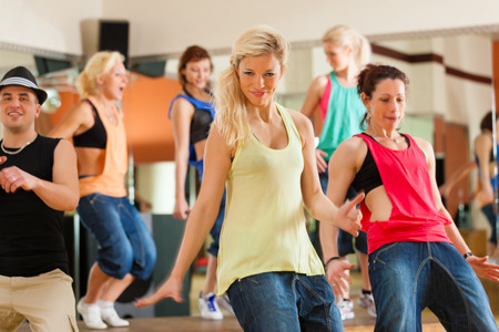 dance studio:   Jazzdance - young people dancing in a studio or gym doing sports or practicing a dance number