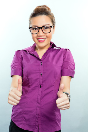 Asian Business woman having success showing it by giving a thumbs up  Stock Photo