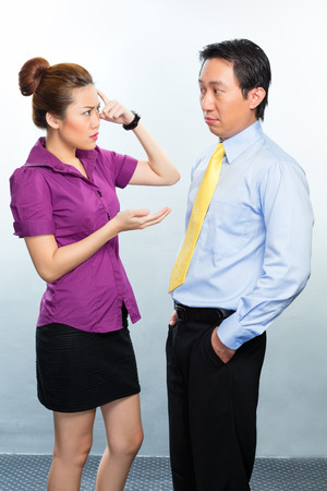 Angry argument among colleagues in an Asian business office photo