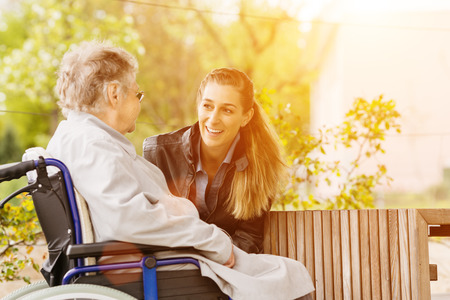 mature old generation: Young woman is visiting her grandmother in nursing home