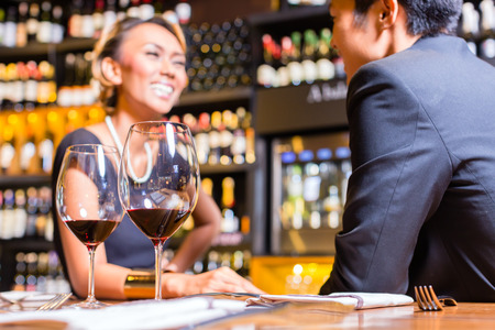 Asian Couple chatting in a wine shop photo