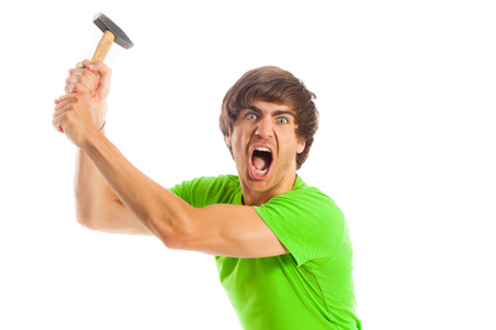 hammering: Man with hammer is hammering