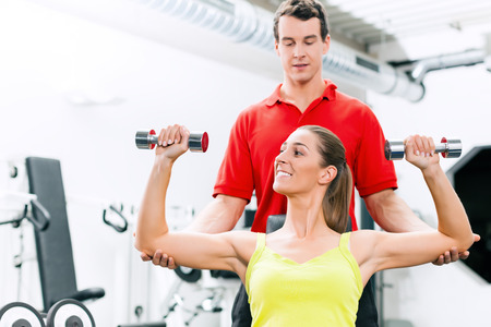 Personal trainer in gym for better fitness photo