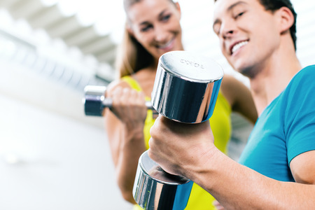 Couple training for fitness in gym with weigts photo