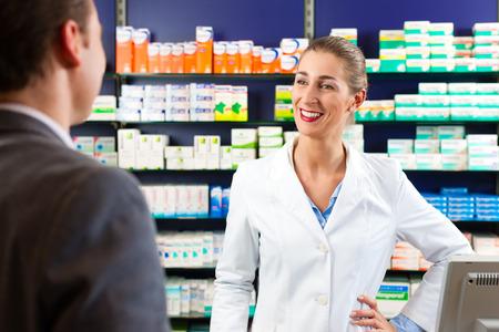 women s health: Female pharmacist consulting a customer in pharmacy Stock Photo