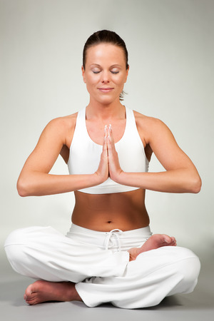 asanas: Young woman in a yoga position