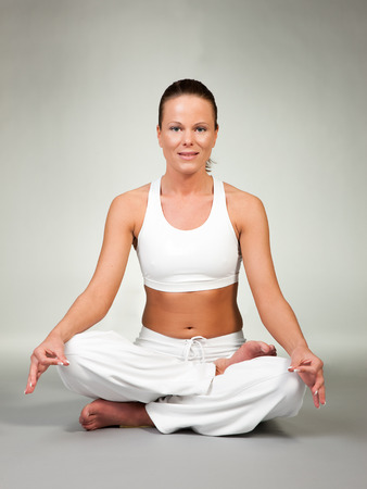 asanas: Young woman in a yoga position  Lotus seat