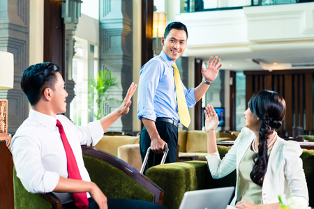 Asian Businesspeople saying goodbye in a hotel Stock Photo