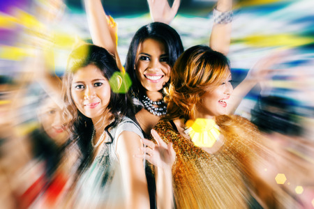 dancing club: Asian beautiful friends dancing on disco floor having fun at fancy night club